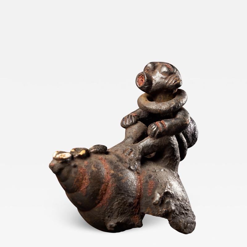 Ceremonial Monkey Figure on a Snailshell Bulu People Cameroon
