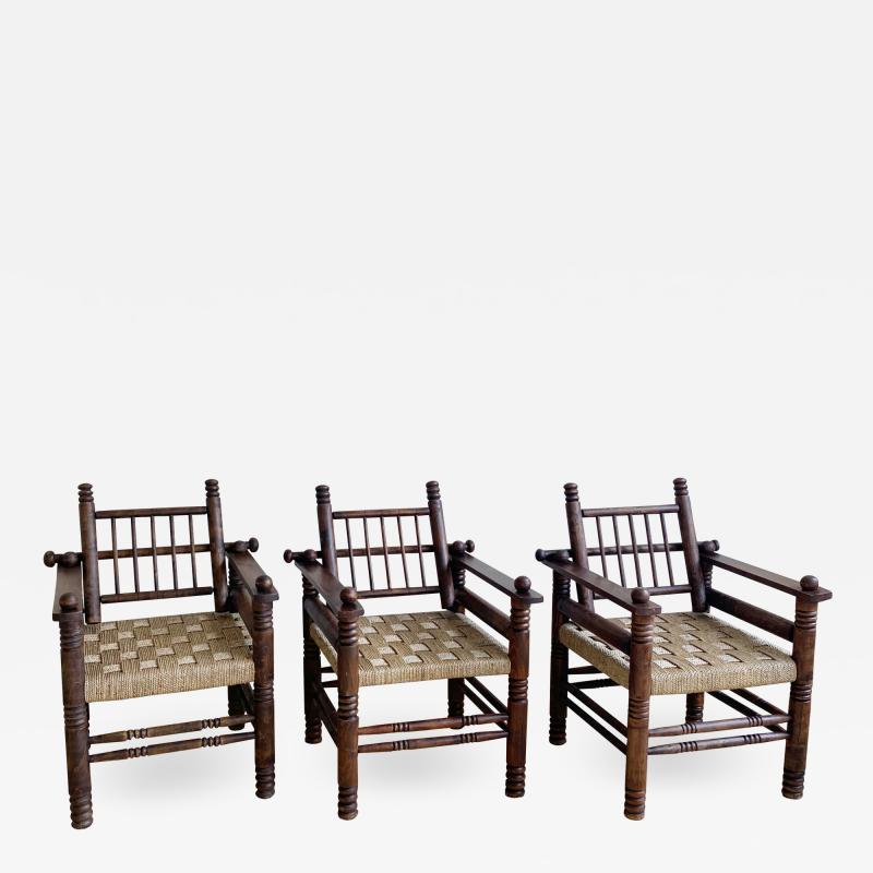 Charles Dudouyt THREE CHARLES DUDOUYT RUSH SEAT ARM CHAIRS