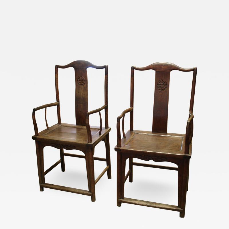 Chinese Qing period elm yoke back armchairs