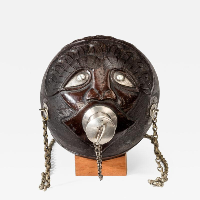 Coconut shell bugbear powder flask with silver mounts and carrying chain
