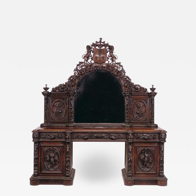 Colossal English Victorian period carved oak sideboard and mirror