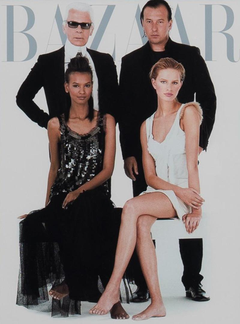 Cover photo of Karl Lagerfeld with models for Bazaar magazine