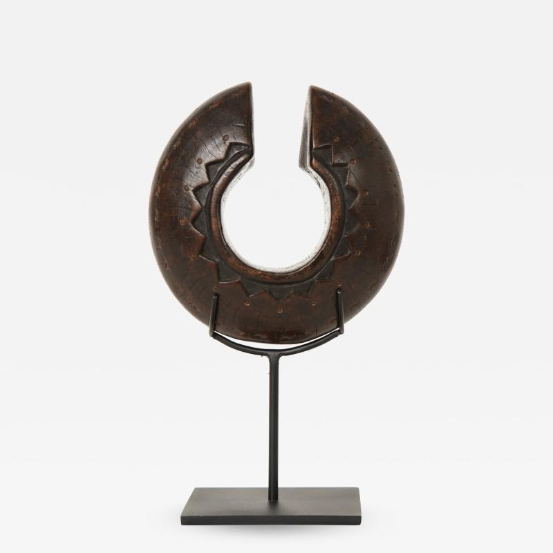 Early 20th Century Danka Wood Bracelet on Later Iron Stand Lucca and Co