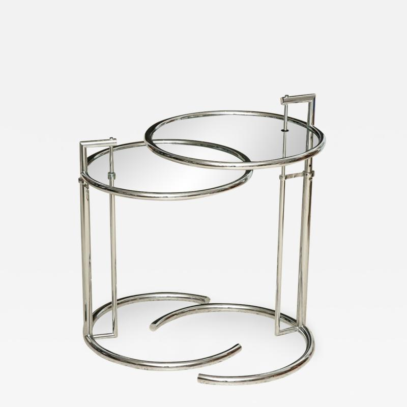 Eileen Gray A Pair of Eileen Gray Polished Chrome and Glass Tables
