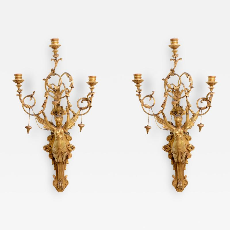 Exceptional Pair of Italian Empire Giltwood Three Light Wall Appliques