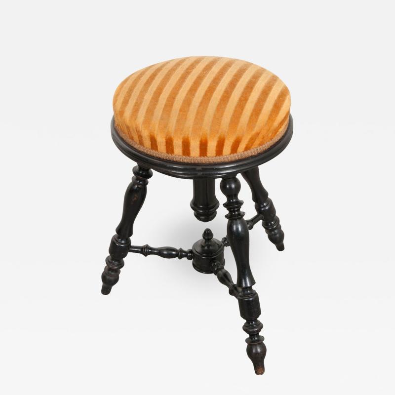 FRENCH EARLY 20TH CENTURY EBONY PIANO STOOL