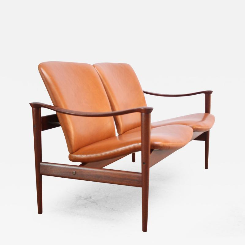 Fredrik A Kayser Fredrik Kayser Loveseat in Leather and Teak