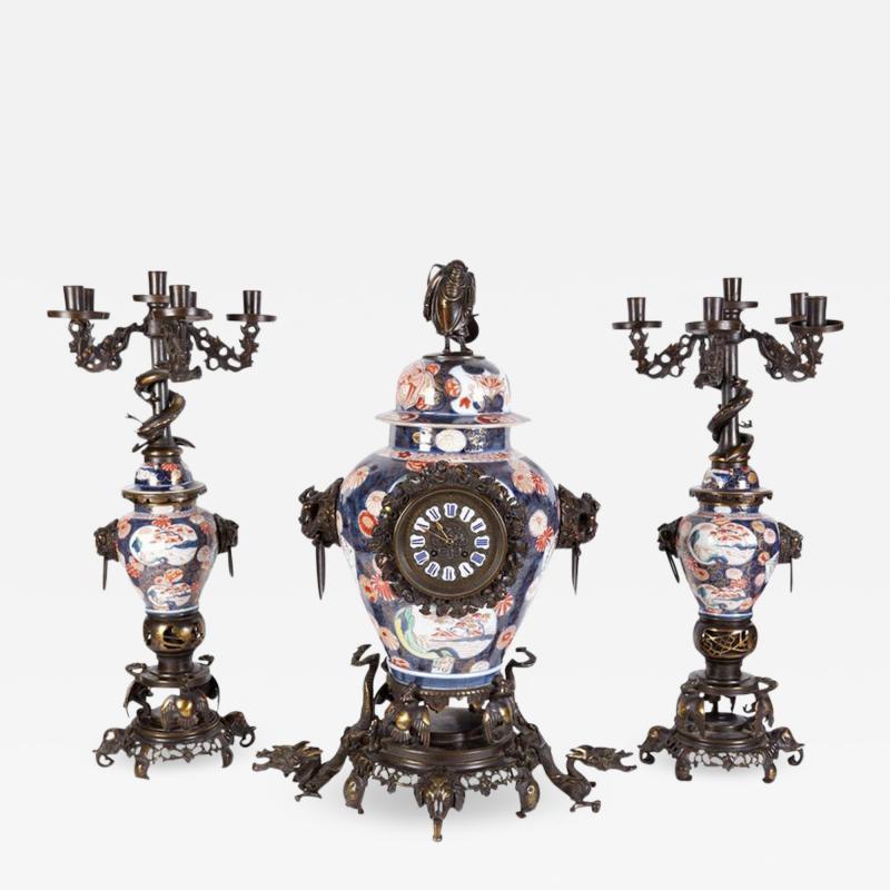 French Japonisme Parcel Gilt Patinated Bronze Imari Porcelain Clock Garniture