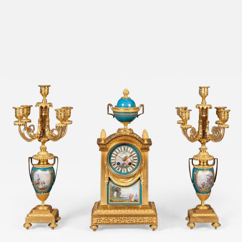 French Mantel Clock and Candelabra of Gilt Bronze and Blue Se vres Porcelain