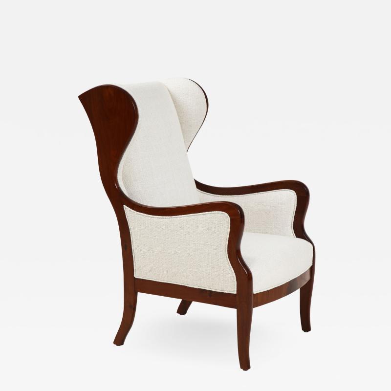 Frits Henningsen A Frits Henningsen Mahogany and Upholstered Wing Chair Circa 1940 50