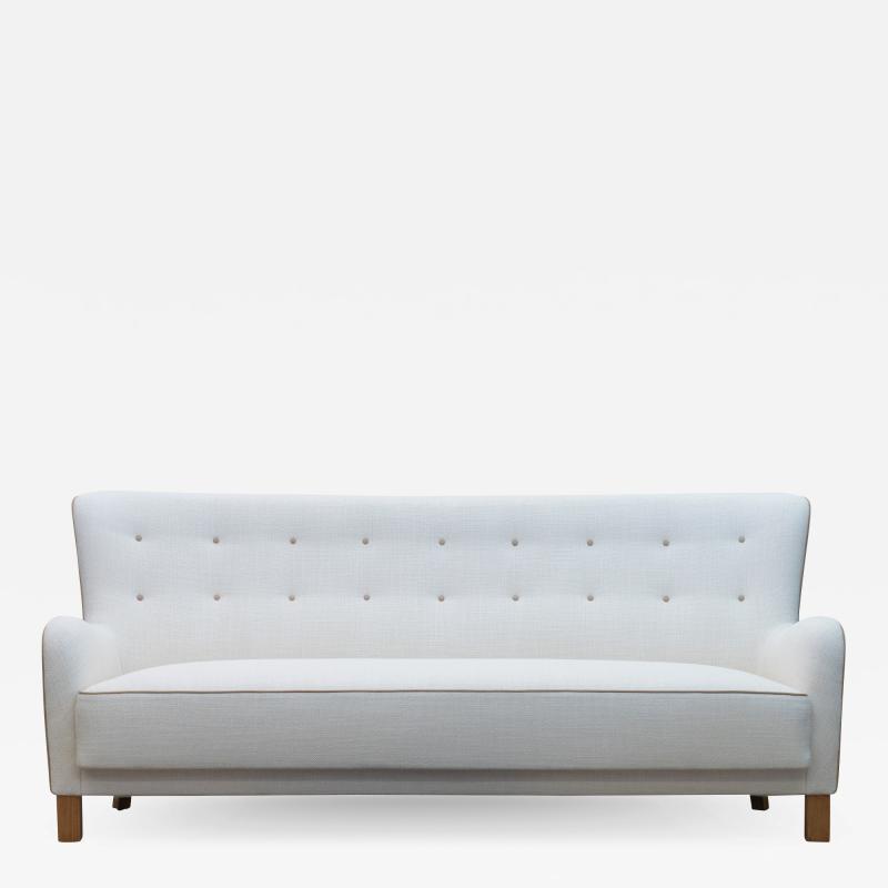 Fritz Hansen Fritz Hansen attributed Long Danish Sofa in Ivory Weave Leather Accents