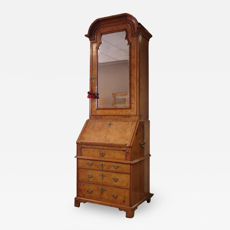 George I period burl walnut and feather banded bureau cabinet of small size