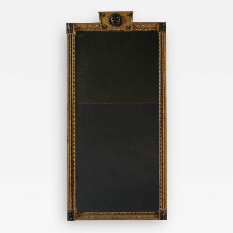 Giltwood And Composition Mirror In The Egyptian Taste With Faux Bronze Detailing