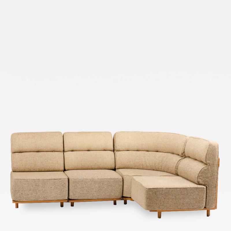 Guillerme et Chambron A four part sofa in solid oak by French designers Guillerme et Chambron