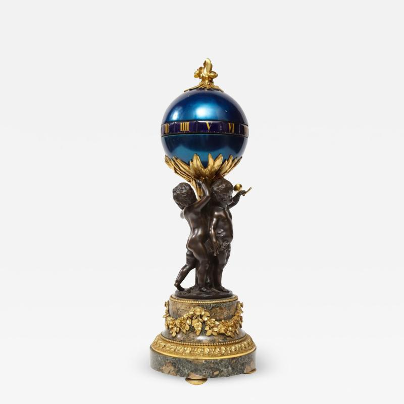 Henry Dasson Henry Dasson a French Gilt and Patinated Bronze Marble and Enamel Annular Clock