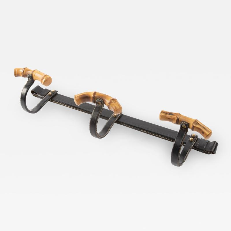 Jacques Adnet A hanger by Jacques Adnet