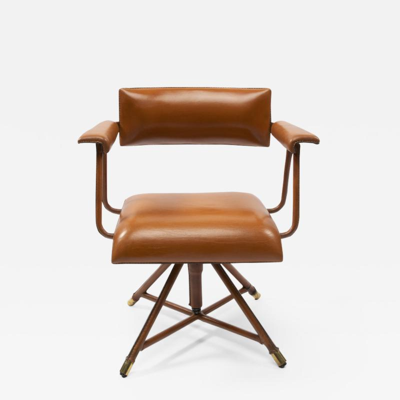 Jacques Adnet A midcentury cognac leather swivel chair