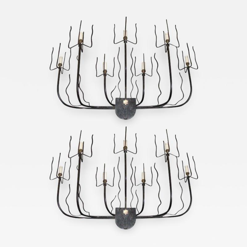 Jacques Adnet A pair of 1950 s wall lights by Jacques Adnet