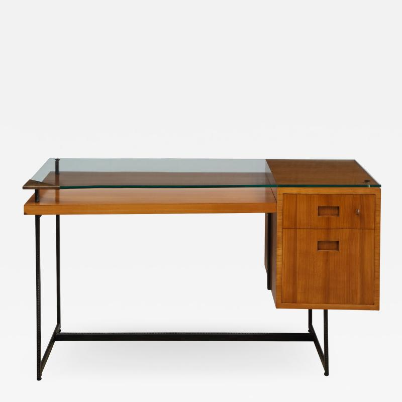 Jacques Adnet Fruitwood desk with iron legs wrapped in leather and glass top by Adnet