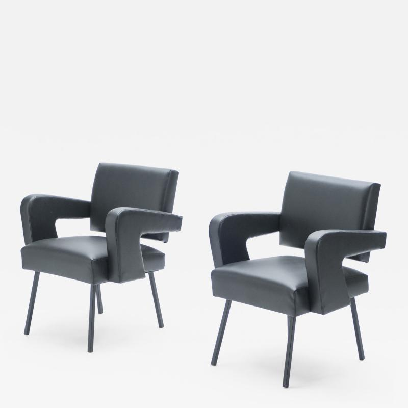 Jacques Adnet Pair of Jacques Adnet President leatherette armchairs 1959