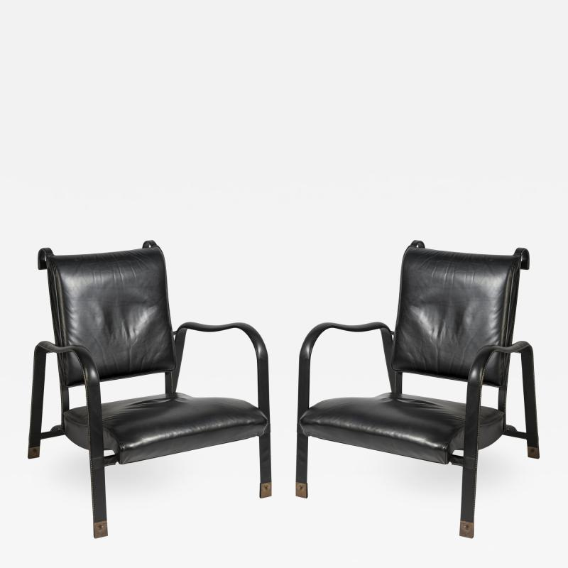 Jacques Adnet Pair of Stitched leather armchairs by Jacques adnet