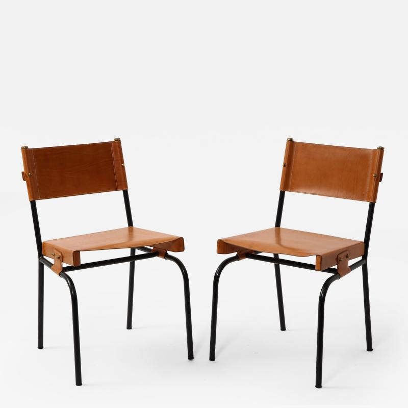 Jacques Adnet Pair of light cognac leather dining chairs by Jacques Adnet