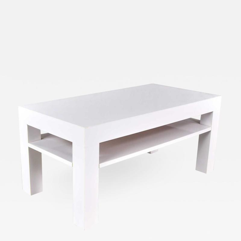 Jean Michel Frank Mid century modern two tiered white laminate parson s style coffee or end table