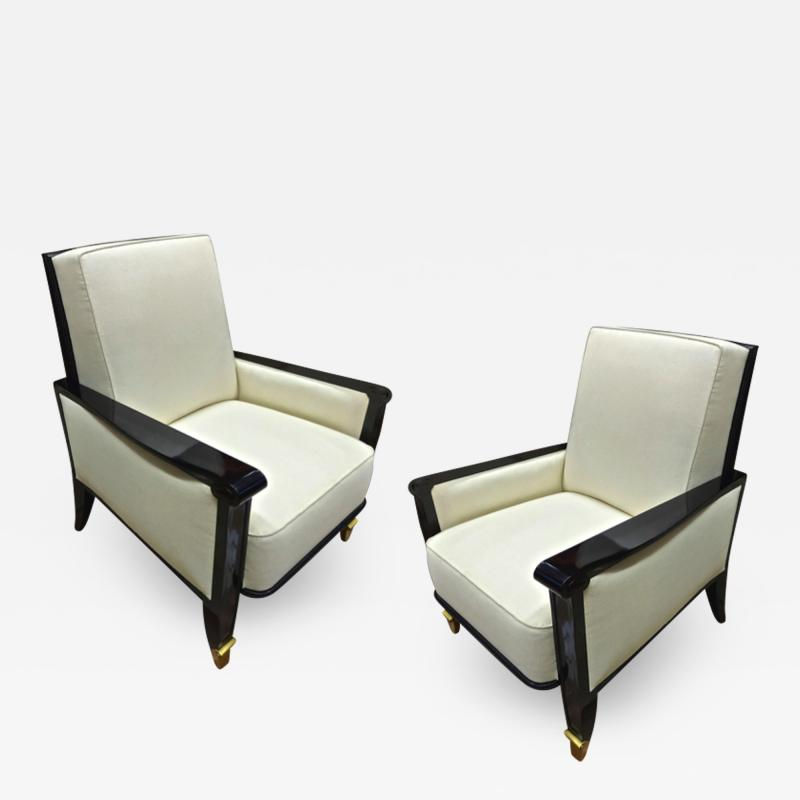 Jean Pascaud Jean Pascaud documented pair of black lacquered arm chairs with gold end leg