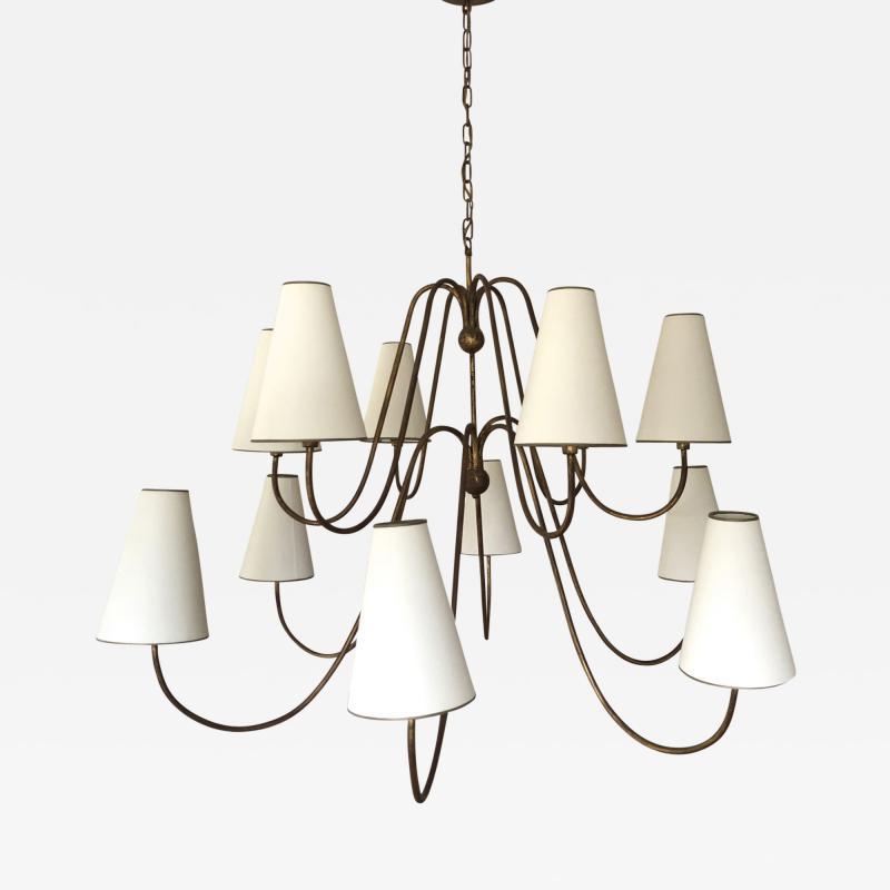 Jean Roy re Jean Royere documented 12 light gold leaf metal chandelier