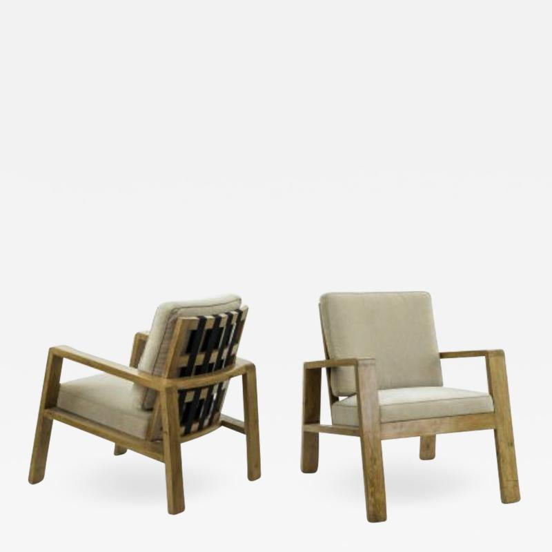 Jean Roy re Jean Royere pair of documented oak slender lounge chairs