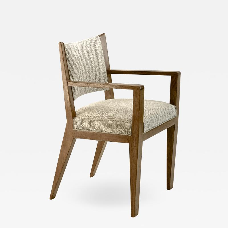 Jean Roy re Jean Royere refined oak arm chair newly covered In boucle cloth