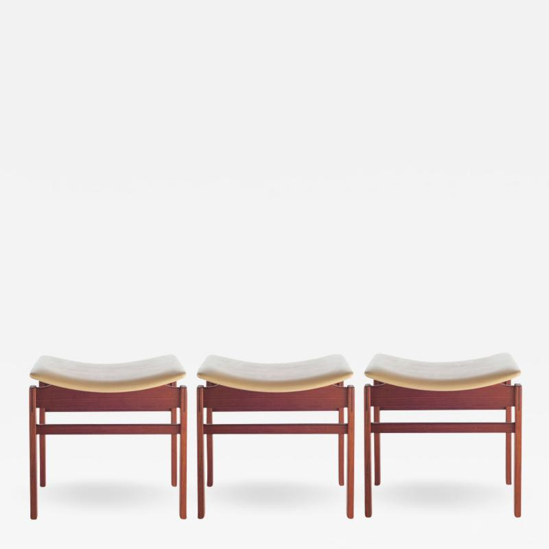 Jens Risom Set of Three Walnut and Leather Stools by Jens Risom