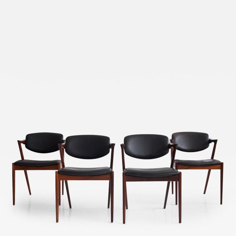 Kai Kristiansen Set of Four Model 42 Black Leather and Hardwood Chairs by Kai Kristiansen