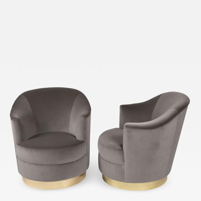 Karl Springer Pair of Karl Springer swivel armchairs with polished brass bases circa 1980s