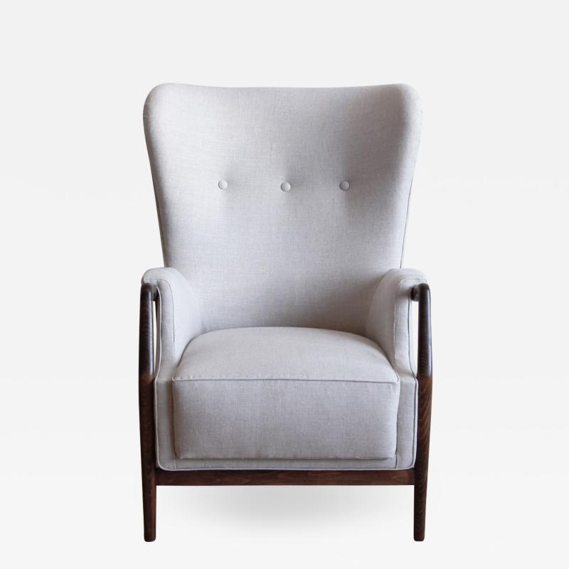 Kurt Olsen High Wingback Chair by Kurt Olsen