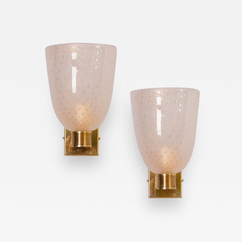 L 27 modernist pair of brass mounted murano glass sconces