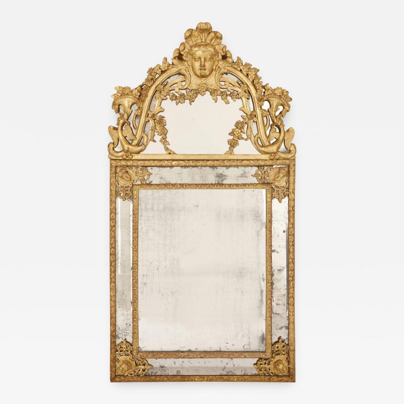 Large R gence period carved giltwood wall mirror