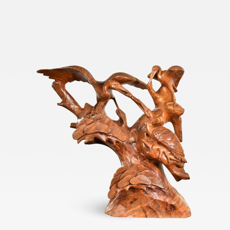 Large hand carved teak asian sculpture of a trio of cranes on a ginkgo tree