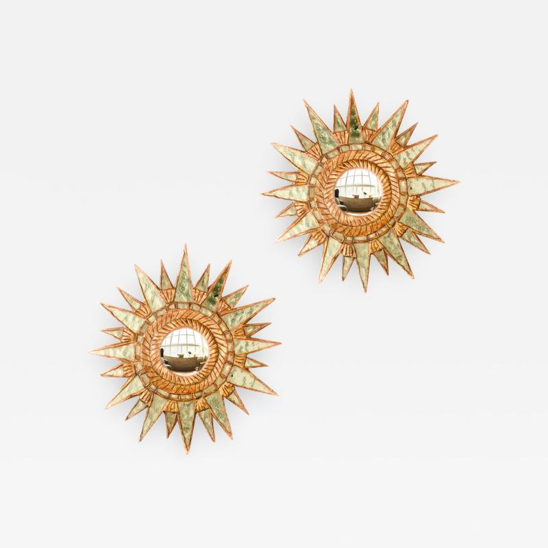 Line Vautrin A pair of small silver leaf starburst mirrors in the manner of Line Vautrin