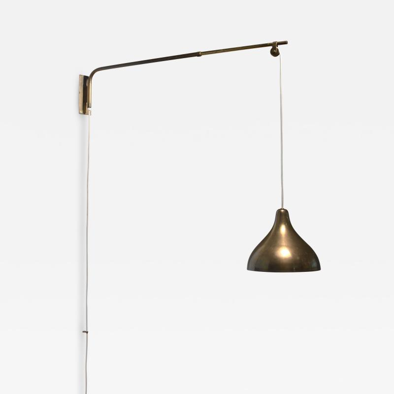 Lisa Johansson Pape Swiveling and extending brass wall lamp