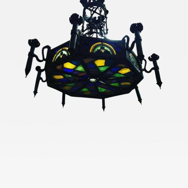 Louis Comfort Tiffany MONUMENTAL GOTHIC IRON AND ORNATE STAINED GLASS PANEL CHANDELIER