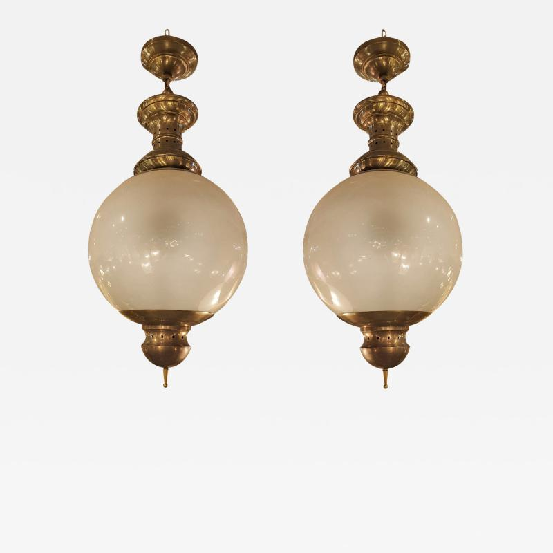 Luigi Caccia Dominioni Pair of large Mid Century Modern brass glass chandeliers by Dominioni 1960s
