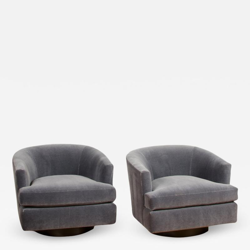 Milo Baughman A pair of Mid Century barrel back swivel chairs in the manner of Milo Baughman
