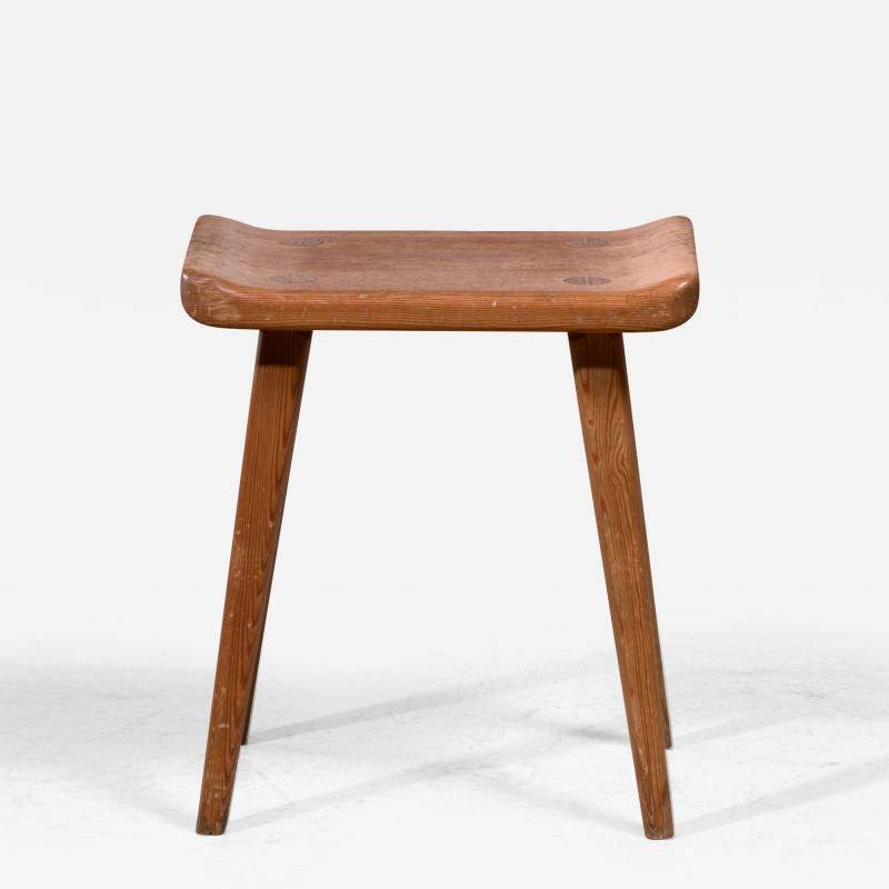 Modernist stool in old pine wood