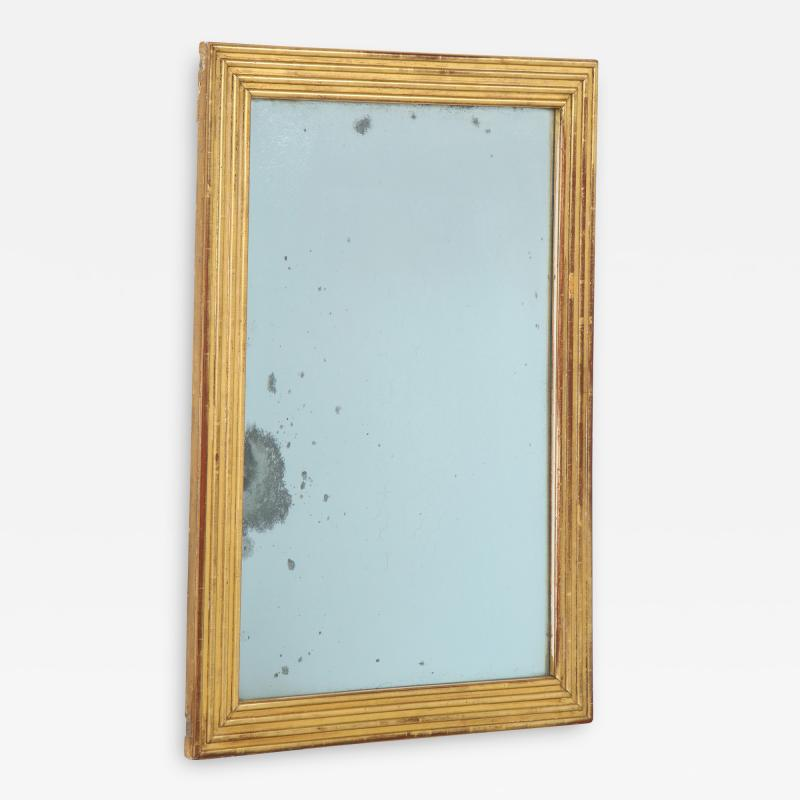 Neoclassical Italian gilded rectangular mirror with ribbed carving