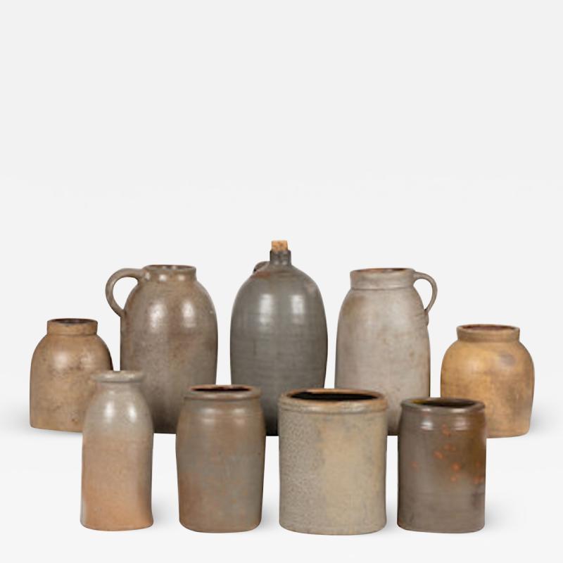 Nine Stoneware Bottles Jugs and Jars