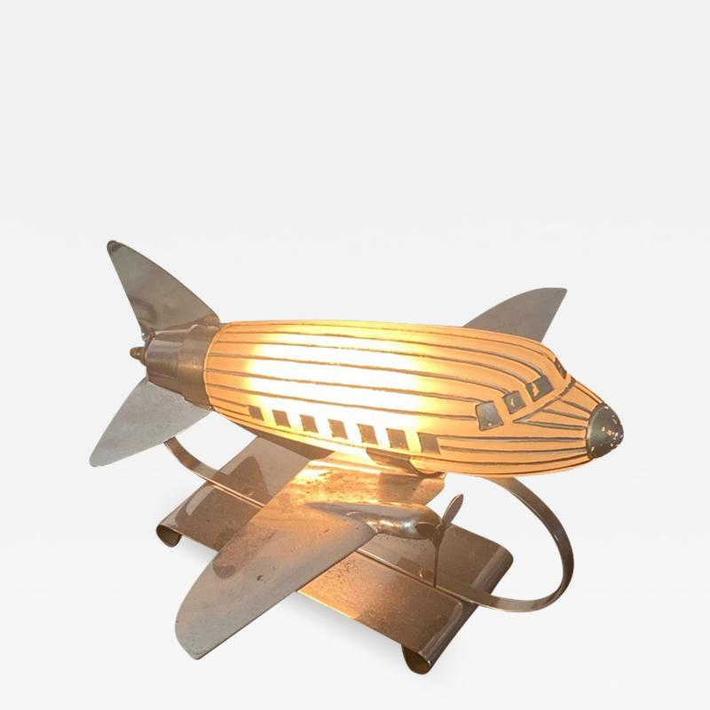 ORIGINAL ART DECO GLASS AND CHROME AIRPLANE LAMP