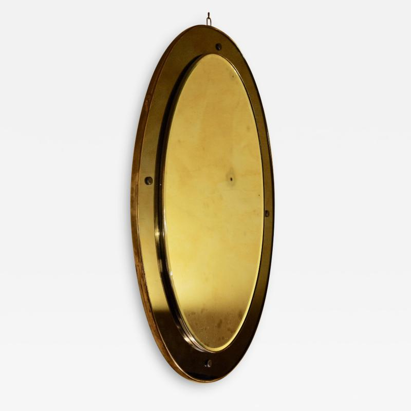 OVAL MIRROR IN WOOD BRASS WITH CURVED AND GROUND COLORED GLASS