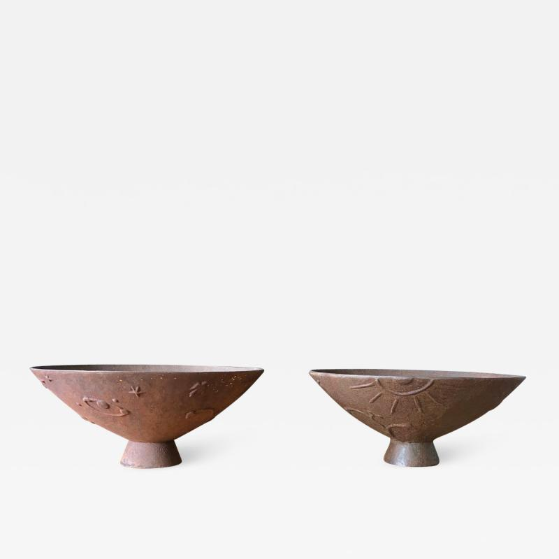 Olof Hult A pair of cast iron urns Mikrokosmos designed by Olof Hult