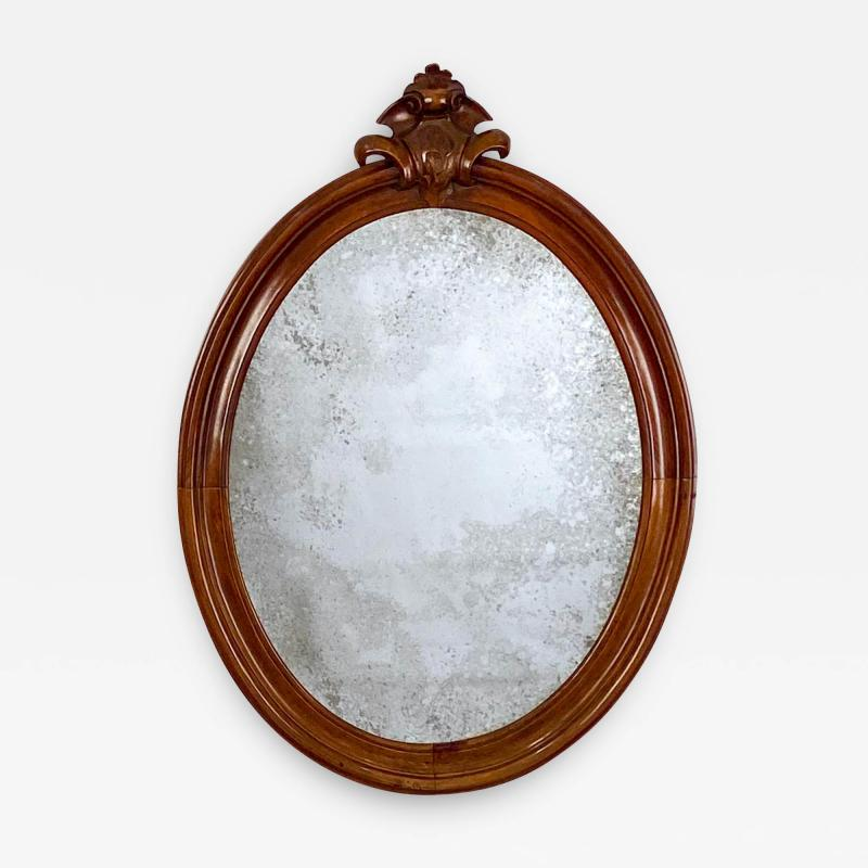 Oval Mirror with a Crest American 19th Century